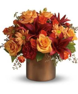 red lilies and orange roses in copper container